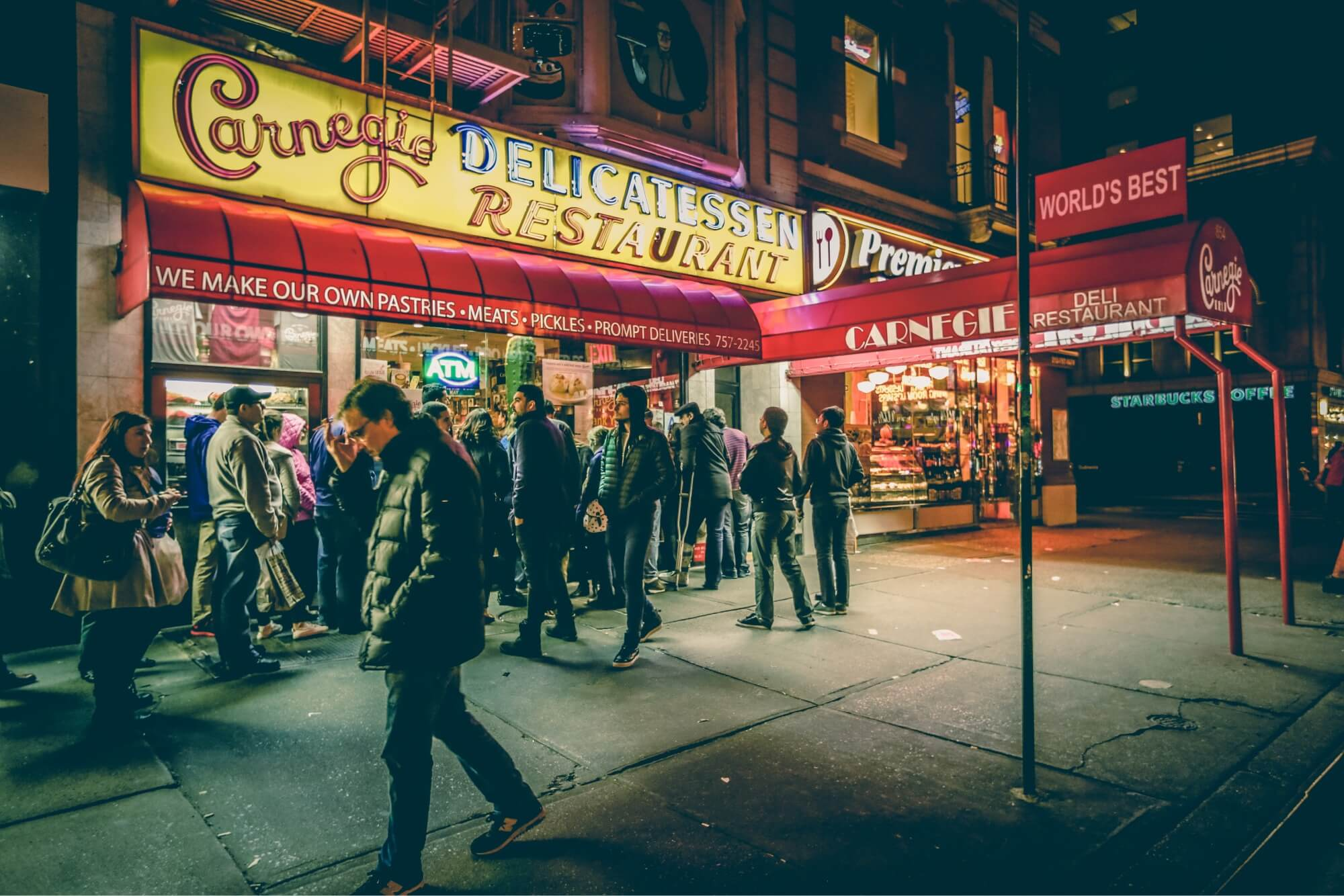 Restaurants like the delicatessan photographed with a long line out the front door are constantly looking for ways to maximize table turn time so that they can serve more guests each day.